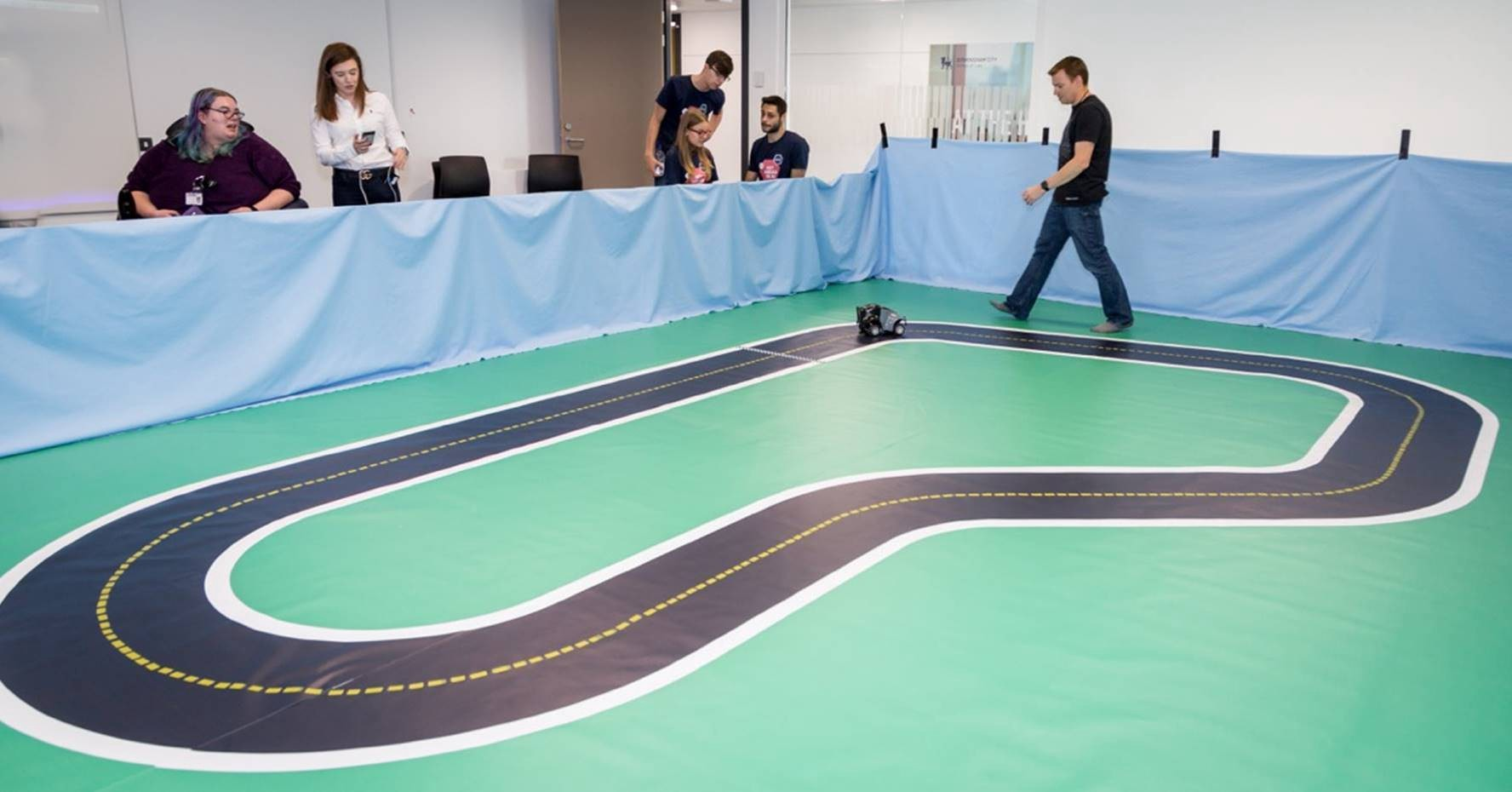 Person walking around a large RC car track